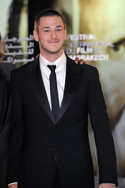 Gaspard Ulliel looked dashing in a narrow black tie at the Marrakech Film Festival.