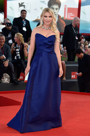 Zhanna Bianca walked the Venice Film Festival red carpet looking regal in a blue strapless gown by Alberta Ferretti.