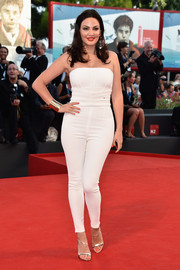Bleona Qereti sheathed her curves in a strapless white jumpsuit for the Venice Film Festival opening ceremony.
