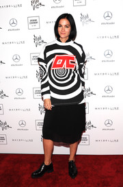 Leigh Lezark attended the Opening Ceremony Spring 2019 show wearing a graphic sweater from the label.
