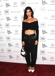 Rainey Qualley punctuated her black outfit with white pumps.