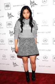 Awkwafina completed her ensemble with black ankle boots.