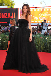 OMG! Elisa Sednaoui looked spectacular in this over-the-top black feathered ballgown at the Venice Film Festival.