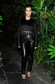 Kourtney Kardashian teamed a tasseled black crop-top with high-waisted leather pants for the launch of the #mycalvins Denim Series.