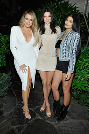 Kylie Jenner added some modesty to her crop-top and shorts combo with a patterned cropped jacket, also by Balmain.