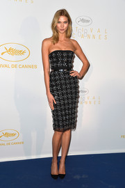 Karlie Kloss looked downright elegant in a beaded black strapless dress by Christian Dior during the Cannes opening ceremony dinner.