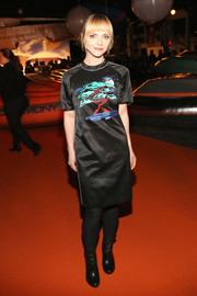 Christina Ricci was casual and sporty in a black T-shirt dress by Opening Ceremony during the brand's fashion show.
