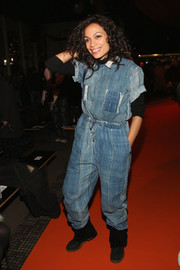 Rosario Dawson was utilitarian-chic in a baggy denim jumpsuit at the Opening Ceremony fashion show.