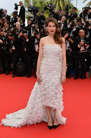 Laetitia Casta chose an appliqued white Christian Dior Couture strapless gown featuring a high-low hem and a flowing train for the 'Grace of Monaco' premiere.