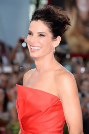 Sandra pulled up her hair into a messy, twisted style for gravity-defying 'do on the red carpet.