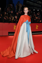 Elle Fanning looked absolutely stunning in a caped color-block gown by Valentino Couture at the Berlinale opening ceremony.