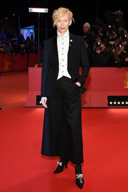 Tilda Swinton styled her suit with a pair of pearl-embellished brogues, also by Chanel.