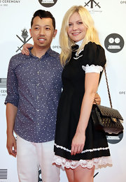 Kirsten attended an event in Japan donning a coveted chain strap quilted shoulder bag.