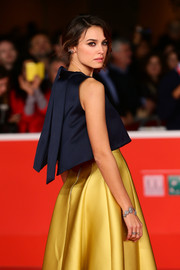 Kasia Smutniak paired a gorgeous diamond bracelet with navy and yellow separates for her Rome Film Festival red carpet look.