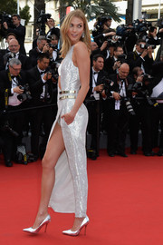 Karlie Kloss was ultra modern, sexy, and glam all at once in this asymmetrical silver one-leg jumpsuit by Atelier Versace at the Cannes Film Festival opening ceremony.