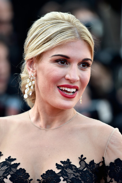 Hofit Golan attended the Cannes Film Festival opening ceremony wearing her hair in a voluminous chignon.