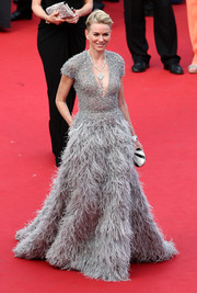 Naomi Watts made our jaws drop with this stunner of a gown at the Cannes opening ceremony, an Elie Saab Couture masterpiece featuring a beaded bodice and a voluminous feathered skirt.