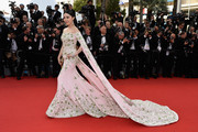 Fan Bingbing made the grandest entrance at the Cannes Film Festival opening ceremony in an embroidered pink Ralph & Russo Couture off-the-shoulder gown with a long watteau train.