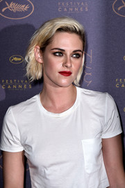 Kristen Stewart went for a bold beauty look with heavily lined eyes.