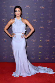 Eva Longoria arrived for the Cannes opening gala dinner wearing a floor-sweeping lilac halter gown.