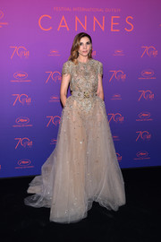 Clotilde Courau looked downright regal in a beaded tulle gown by Elie Saab Couture at the 2017 Cannes Film Festival opening gala.
