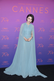 Fan Bingbing attended the Cannes Film Festival opening gala dinner looking like royalty in her caped blue Elie Saab Couture gown.