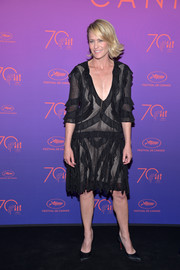 Robin Wright attended the Cannes Film Festival opening gala dinner wearing a loose, ruffled LBD.