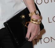 Cheryl Tiegs showed off her gold watch while hitting the red carpet at the Louis Vuitton store opening.