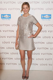 Eva showed off her shimmering cocktail dress while hitting the store opening of Louis Vuitton.