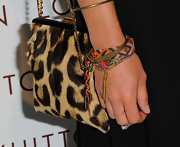 Gillian paired her red carpet ensemble with a sleek leopard print evening bag.