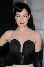 Dita Von Teese showed off her medium curls while hitting the Louis Vuitton store opening.