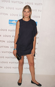 Gabrielle left her swimsuit at home and opted for a simple navy day dress while attending the opening of the Louis Vuitton store.