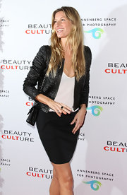 Gisele Bundchen channeled ladylike elegance at the Beauty Culture soiree in a white tee paired with a chic black pencil skirt.