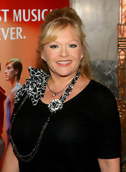 Charlene Tilton pulled off an all-black outfit by wearing a nice multi-strand necklace with ribbon detailing.