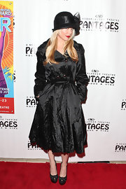 Charlotte wears a black trench for this red carpet style.