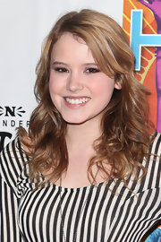 Taylor Spreitier styled her honey brown tresses in soft curls.