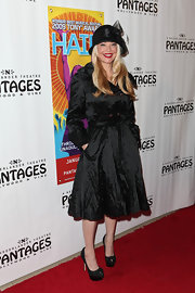 Charlotte Ross donned sweet black platforms adorned with darling bows.