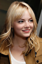 Emma Stone stuck to her signature wavy 'do for a night at the 'Bull at Brits' after party.