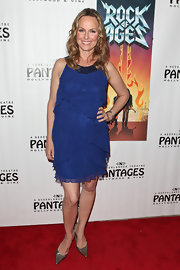 Melora Hardin added a sultry finish to her blue cocktail dress with pointy silver pumps.