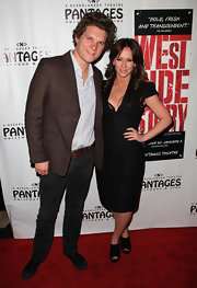 Jamie Kennedy toned down the formality of his luxe brown jacket by pairing it with dark denim jeans at the Opening night of 'West Side Story.'