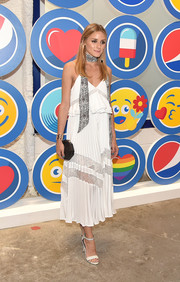 Olivia Palermo complemented her frock with simple white ankle-strap sandals.