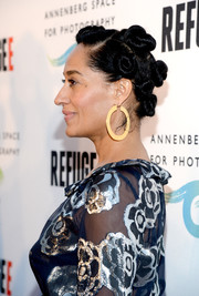 Tracee Ellis Ross sported a head full of knots at the REFUGEE exhibit opening.