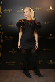 Gwen Stefani looked party-ready in a Gucci LBD with a sequined neckline and sleeves during the opening of the Renaissance Downtown Hotel in Dubai.