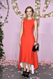 Eva Herzigova kept it minimal yet elegant in a sleeveless red high-low dress by Dior during the Ballet National de Paris opening season gala.