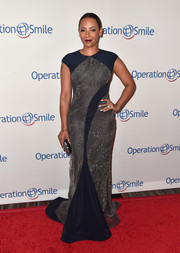 Melanie Brown looked totally glam at the Smile Gala in a figure-flaunting navy gown with silver beading.