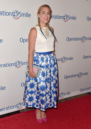 Busy Philipps topped off her adorable look with a 'Jane Eyre' book clutch.