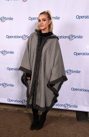 Ashlee Simpson got all covered up in an oversized gray poncho for the Celebrity Ski & Smile Challenge.