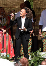 Andra Day went menswear-chic in a black pantsuit during Oprah Winfrey's Gospel Brunch.