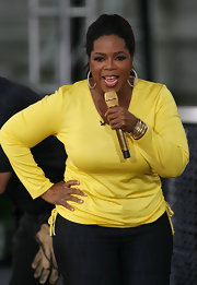Oprah Winfrey kept it simple with a bright yellow scoopneck sweater during her show's season 24 kickoff party.