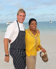 Oprah Winfrey brought a bit of glam to the beach with this beaded yellow blouse.